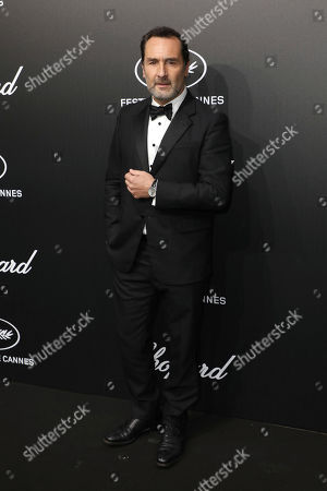 Gilles Lellouche poses for photographers upon arrival at the Chopard Trophee event at the 72nd international film festival, Cannes, southern France