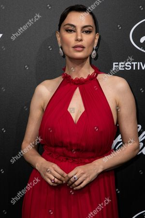 Catrinel Marlon poses for photographers upon arrival at the Chopard Trophee event at the 72nd international film festival, Cannes, southern France