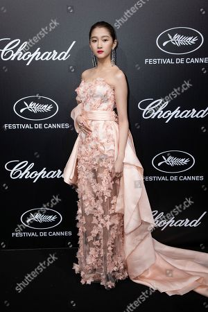 Guan Xiaotong poses for photographers upon arrival at the Chopard Trophee event at the 72nd international film festival, Cannes, southern France