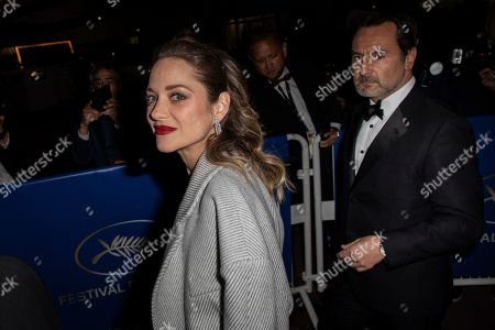 Marion Cotillard, Gilles Lellouche. Actress Marion Cotillard and Gilles Lellouche pose for photographers upon arrival at the Chopard Trophee event at the 72nd international film festival, Cannes, southern France