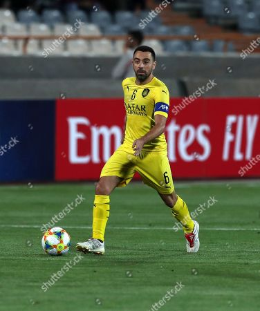 Qatar's Al-Sadd player Xavi Hernández, a former Barcelona and Spain's midfielder, plays with the ball during his final match with Iran's Persepolis in AFC Champions League at the Azadi stadium in Tehran, Iran, . Xavi Hernandez retired from soccer as a player. He quit international football in 2014 and left Barcelona one year later after 17 seasons. He has since played for Al-Sadd in Qatar while preparing for a future as a manager