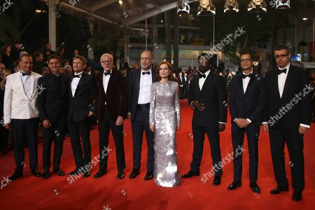 Stock Photo of Michel Merkt, Mauricio Zacharias, Ariyon Bakare, Isabelle Huppert, Ira Sachs, Pascal Greggory, Jeremie Renier. Actor Michel Merkt, from right, screenwriter Mauricio Zacharias, actors Ariyon Bakare, Isabelle Huppert, director Ira Sachs, actors Pascal Greggory, and Jeremie Renier pose for photographers upon arrival at the premiere of the film 'Frankie' at the 72nd international film festival, Cannes, southern France
