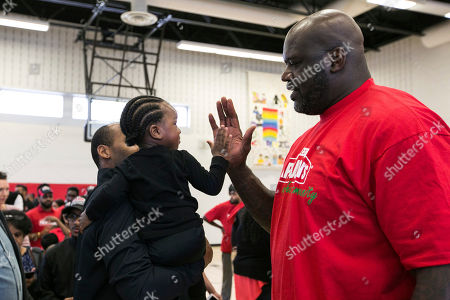 Stock Photo of JOHN'S- Papa John's newest Board Member and investor, NBA legend Shaquille O'Neal, visits the Boys & Girls Club of East Scarborough to celebrate Papa John's Annual Day of Service on in Toronto, Ontario, Canada