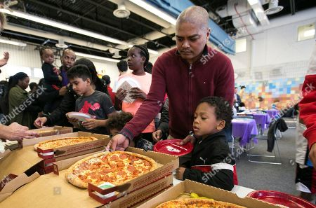 JOHN'S- Members of the Boys and Girls Club of East Scarborough enjoy Papa John's pizza delivered by Papa John's newest Board Member and investor, NBA legend Shaquille O'Neal, on in Toronto, Ontario, Canada