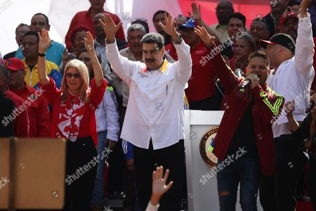 President of Venezuela Nicolas Maduro (C) and the first lady Cilia Flores (C-L) participate in an act of government to celebrate the first anniversary of the elections in Venezuela, of which Maduro proclaimed himself the winner, and that have not been recognized by the international community due to alleged irregularities, in Caracas, Venezuela, 20 May 2019.