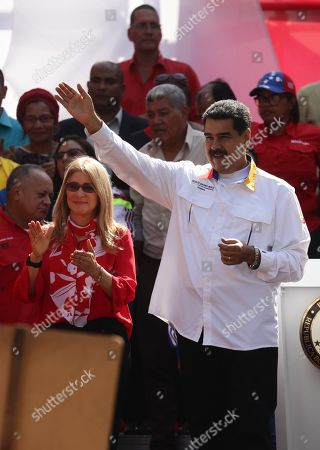 President of Venezuela Nicolas Maduro (R) and the first lady Cilia Flores (L) participate in an act of government to celebrate the first anniversary of the elections in Venezuela, of which Maduro proclaimed himself the winner, and that have not been recognized by the international community due to alleged irregularities, in Caracas, Venezuela, 20 May 2019.