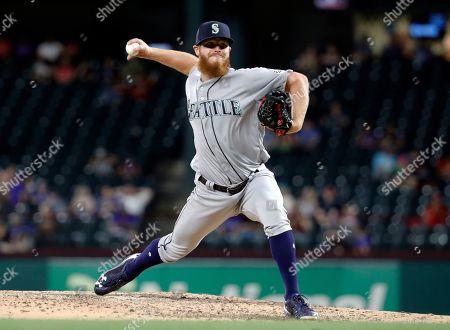 Seattle Mariners' David McKay throws the first pitch in his Major League Baseball debut in the eighth inning of a game against the Texas Rangers in Arlington, Texas