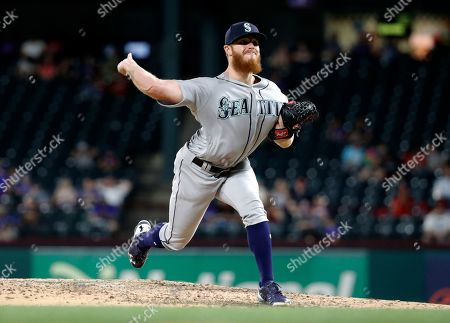 Seattle Mariners David McKay throws the first pitch in his Major League debut in the eight inning of a baseball game against the Texas Rangers in Arlington, Texas