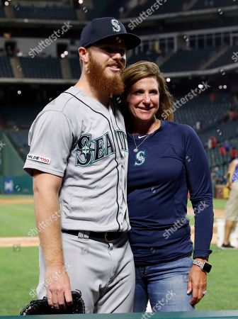 Tracey Calinan, David McKay. Seattle Mariners relief pitcher David McKay, left, poses for a photo with his mother Tracey Calinan, right, after their baseball game against the Texas Rangers in Arlington, Texas, . McKay made his Major League debut in the 10-9 Rangers win