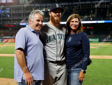 Tracey Calinan, David McKay, David McKay. Seattle Mariners relief pitcher David McKay, center, poses for a photo with his mother father David McKay, left, and mother Tracey Calinan, right, after their baseball game against the Texas Rangers in Arlington, Texas, . McKay made his Major League debut in the 10-9 Rangers win