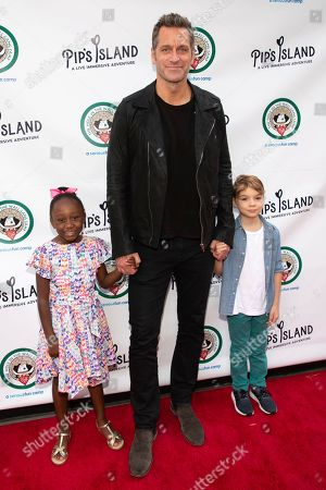 "Stock Picture of Peter Hermann, Amaya Josephine Hermann, Andrew Nicolas Hermann. Peter Hermann, center, Amaya Josephine Hermann, left, and Andrew Nicolas Hermann attend the opening night of ""Pip's Island"" at 400 West 42nd Street, in New York"