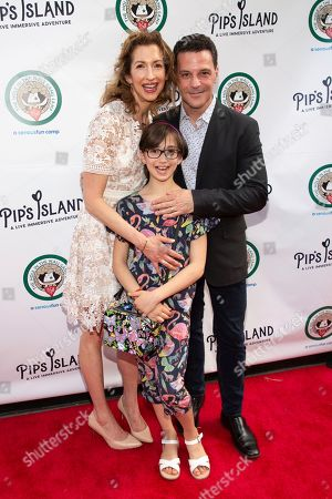 "Alysia Reiner, Livia Charles Basche, David Alan Basche. Alysia Reiner, from left, Livia Charles Basche, and David Alan Basche attend the opening night of ""Pip's Island"" at 400 West 42nd Street, in New York"