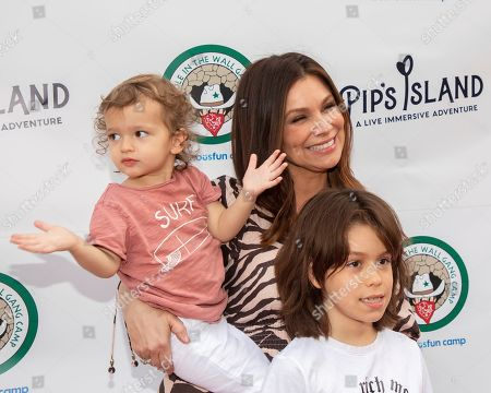 """Stock Image of Gretta Monahan, Rio Goldin, Kai Goldin. Gretta Monahan, center, Rio Goldin, left, and Kai Goldin attend the opening night of """"Pip's Island"""" at 400 West 42nd Street, in New York"""