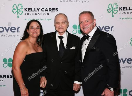 Brian Kelly, Paqui Kelly, Raymond Kelly. Notre Dame Head Football Coach Brian Kelly and his wife Paqui, co-founders of the Kelly Cares Foundation, are pictured with former NYC Police Commissioner Raymond Kelly, center, at the Foundation's Annual Irish Eyes Gala, in New York. To date, the Foundation has provided more than $5 million to support health and education initiatives worldwide