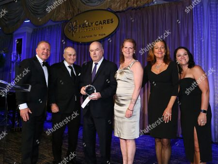 Brian Kelly, Paqui Kelly, Raymond Kelly, Ed Broderick, Eileen Rafferty, K.C. Fuchs. Notre Dame Head Football Coach Brian Kelly, left, and his wife Paqui Kelly, right, present the Spirit of Giving Award with former NYC Police Commissioner Raymond Kelly, second left, to the Silver Shield Foundation represented by, center left to right, Ed Broderick, Eileen Rafferty and K.C. Fuchs, at the Kelly Cares Foundation's Annual Irish Eyes Gala, in New York. To date, the Foundation has provided more than $5 million to support health and education initiatives worldwide