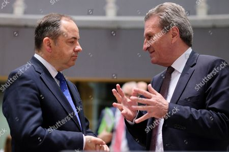 EU Budget Commissioner, German, Gunther Oettinger (R) chats with Konrad Szymanski, the Polish European Affairs Minister during a European general affairs council in Brussels, Belgium, 21 May 2019.