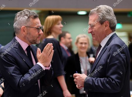 EU Budget Commissioner, German, Gunther Oettinger (R) chats with German Minister of State for European Affairs Michael Roth during a European general affairs council in Brussels, Belgium, 21 May 2019.