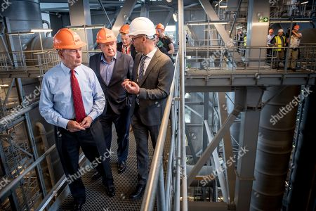 Denmark's Prime Minister Lars Loekke Rasmussen, (C), and former New York City Mayor and UN Secretary-General's Special Envoy on Climate Michael Bloomberg, (L), during a visit to the Amager Resource Center (Amager Bakke) in Copenhagen, Denmark, 21 May 2019.