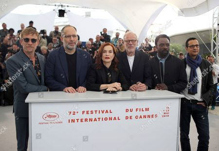 Jeremie Renier, Ira Sachs, Isabelle Huppert, Pascal Greggory, Ariyon Bakare, Mauricio Zacharias. Actor Jeremie Renier, from left, director Ira Sachs, actors Isabelle Huppert, Pascal Greggory, Ariyon Bakare and screenwriter Mauricio Zacharias pose for photographers at the photo call for the film 'Frankie' at the 72nd international film festival, Cannes, southern France