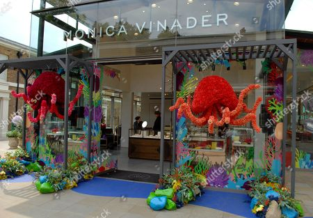 A marine themed flower installation on the shop front of Monica Vinader at Duke of York Square by  King's Rd