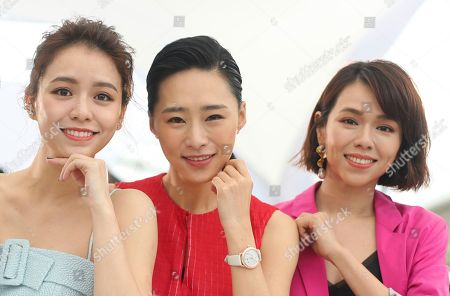 Stock Image of Vivian Sung Yun-hua, Wu Ke-xi, Hsia Yu-chiao. Actresses Vivian Sung Yun-hua, from left, Wu Ke-xi and Hsia Yu-chiao pose for photographers at the photo call for the film 'Nina Wu'' at the 72nd international film festival, Cannes, southern France
