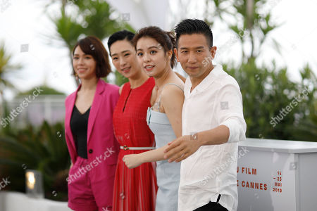 Stock Image of Hsia Yu-chiao, Wu Ke-xi, Vivian Sung Yun-hua, Midi Z. Actresses Hsia Yu-chiao, from left, Wu Ke-xi, Vivian Sung Yun-hua, and director Midi Z pose for photographers at the photo call for the film 'Nina Wu'' at the 72nd international film festival, Cannes, southern France
