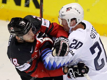 Stock Photo of Ryan Sutter of the US, right, checks Canada's Pierre-Luc Dubois, left, during the Ice Hockey World Championships group A match between Canada and the United States at the Steel Arena in Kosice, Slovakia
