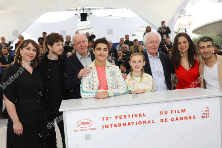 Claire Bodson, Olivier Bonnaud, Luc Dardenne, Idir Ben Addi, Victoria Bluck, Jean-Pierre Dardenne, Miriam Akheddiou, Othman Moumen. Actors Claire Bodson, from left, Olivier Bonnaud, director Luc Dardenne, actors Idir Ben Addi, Victoria Bluck, director Jean-Pierre Dardenne, actors Miriam Akheddiou and Othman Moumen pose for photographers at the photo call for the film 'Young Ahmed' at the 72nd international film festival, Cannes, southern France