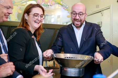 Open Vld (Open Flemish Liberals and Democrats) chairwoman Gwendolyn Rutten (L) and Belgian Prime Minister Charles Michel (R) prepare French fries during a press meeting of French-speaking liberals MR and Flemish liberals Open Vld on their common priorities, in Brussels, Belgium, 21 May 2019. The European Parliament election is held by member countries of the European Union (EU) from 23 to 26 May 2019.