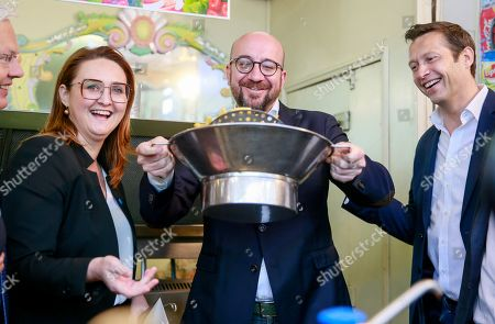 Open Vld (Open Flemish Liberals and Democrats) chairwoman Gwendolyn Rutten (L) and Belgian Prime Minister Charles Michel (C) prepare French fries during a press meeting of French-speaking liberals MR and Flemish liberals Open Vld on their common priorities, in Brussels, Belgium, 21 May 2019. The European Parliament election is held by member countries of the European Union (EU) from 23 to 26 May 2019.