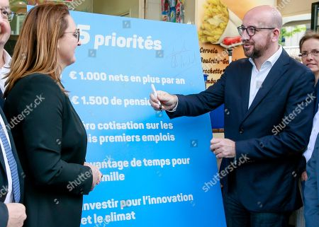 Open Vld (Open Flemish Liberals and Democrats) chairwoman Gwendolyn Rutten (L) and Belgian Prime Minister Charles Michel (R) show a banner with their common priorities during a press meeting of French-speaking liberals MR and Flemish liberals Open Vld on their common priorities, in Brussels, Belgium, 21 May 2019. The European Parliament election is held by member countries of the European Union (EU) from 23 to 26 May 2019.
