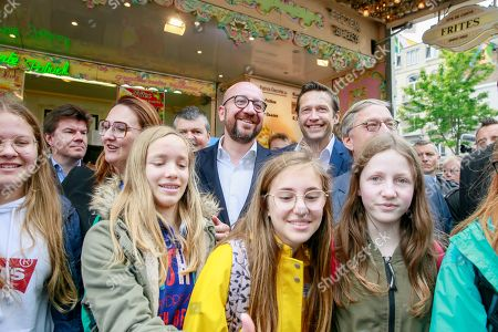Open VLD (Open Flemish Liberals and Democrats) chairwoman Gwendolyn Rutten (L) and Belgian Prime Minister Charles Michel (2-L) pose with students for a picture during a press meeting of French-speaking liberals MR and Flemish liberals Open Vld on their common priorities, in Brussels, Belgium, 21 May 2019. The European Parliament election is held by member countries of the European Union (EU) from 23 to 26 May 2019.