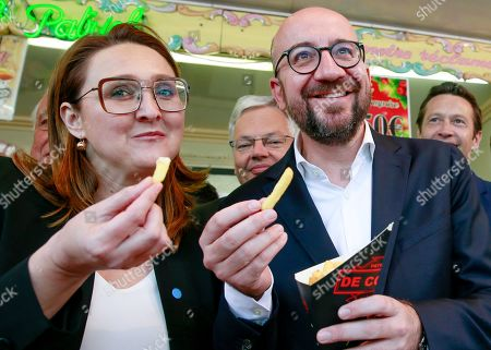 Open Vld (Open Flemish Liberals and Democrats) chairwoman Gwendolyn Rutten (L) and Belgian Prime Minister Charles Michel (R) eat French fries during a press meeting of French-speaking liberals MR and Flemish liberals Open Vld on their common priorities, in Brussels, Belgium, 21 May 2019. The European Parliament election is held by member countries of the European Union (EU) from 23 to 26 May 2019.