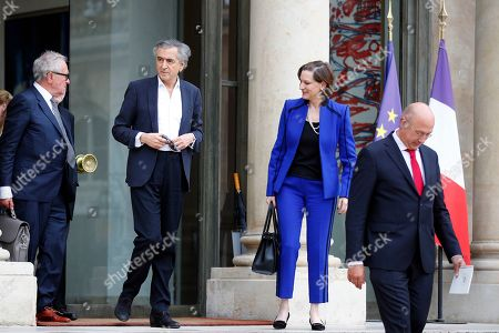 "French philosopher and author Bernard-Henri Levy, second left, walks out with British historian Simon Schama, left, US writer Anne Applebaum, second right, and Netherland's philosopher Rob Riemen, right, after a meeting between French president Emmanuel Macron and other authors and philosophers who signed the tribune ""Europe at risk"" for the upcoming European Union parliament Elections at the Elysee Palace in Paris, France, . The European Union parliament elections will take place in each EU nation between May 23-26 and in France on May 26"