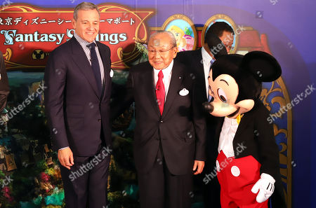 Walt Disney Company chairman Robert Iger (L) smiles with Oriental Land chairman Toshio Kagami and Mickey Mouse as they attend a ground breaking ceremony for Tokyo DisneySea's large expansion area which will be named 'Fantasy Springs' in Urayasu, suburban Tokyo on Tuesday, May 21, 2019. Tokyo DisneySea operator Oriental Land will invest 250 billion yen for the new facilities including 475-guest room luxury in-park hotel and which will open in 2022.