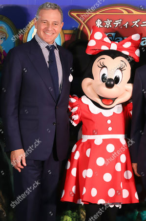 Walt Disney Company chairman Robert Iger smiles with Minnie Mouse as he attends a ground breaking ceremony for Tokyo DisneySea's large expansion area which will be named 'Fantasy Springs' in Urayasu, suburban Tokyo on Tuesday, May 21, 2019. Tokyo DisneySea operator Oriental Land will invest 250 billion yen for the new facilities including 475-guest room luxury in-park hotel and which will open in 2022.