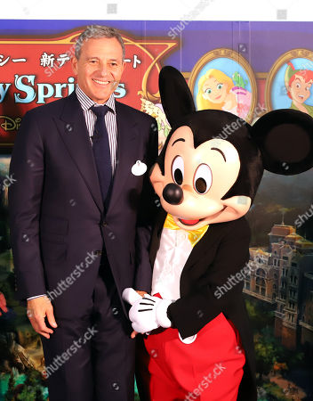 Walt Disney Company chairman Robert Iger smiles with Mickey Mouse as he attends a ground breaking ceremony for Tokyo DisneySea's large expansion area which will be named 'Fantasy Springs' in Urayasu, suburban Tokyo on Tuesday, May 21, 2019. Tokyo DisneySea operator Oriental Land will invest 250 billion yen for the new facilities including 475-guest room luxury in-park hotel and which will open in 2022.