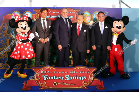 Walt Disney Attractions Japan president Philippe Gas, Walt Disney Company chairman Robert Iger, Oriental Land chairman Toshio Kagami and Oriental Land president Kyoichiro Uenishi pose for photo with Mickey and Minnie Mouse as they attend a ground breaking ceremony for Tokyo DisneySea's large expansion area which will be named 'Fantasy Springs' in Urayasu, suburban Tokyo on Tuesday, May 21, 2019. Tokyo DisneySea operator Oriental Land will invest 250 billion yen for the new facilities including 475-guest room luxury in-park hotel and which will open in 2022.
