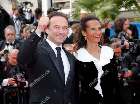 Vincent Perez (L) and his wife Senegalese actress Karine Silla at the screening of 'Once Upon a Time in Hollywood'