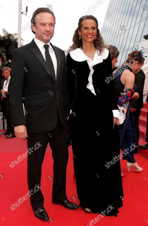 Vincent Perez (L) and his wife French actress and director Karine Silla at the screening of 'Once Upon a Time in Hollywood'