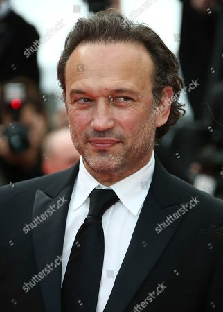 Vincent Perez poses for photographers upon arrival at the premiere of the film 'Once Upon a Time in Hollywood' at the 72nd international film festival, Cannes, southern France
