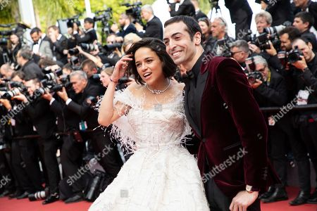 Michelle Rodriguez, Mohammed Al Turki. Michelle Rodriguez and Mohammed Al Turki pose for photographers upon arrival at the premiere of the film 'Once Upon a Time in Hollywood' at the 72nd international film festival, Cannes, southern France