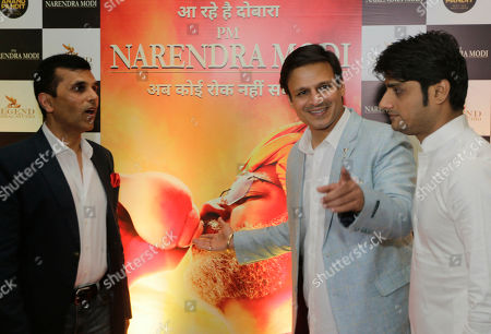 """Bollywood actor Vivek Oberoi, center, stands for photographs during the premiere of the film """"PM Narendra Modi,"""" a film based on the life of the Indian Prime Minister, in Ahmadabad, India, . The film is scheduled to release on May 24, a day after counting o votes of India's general elections"""