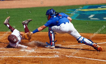 Texas A&M's Ty Coleman (1) beats the tag from Florida Catcher Brady Smith (9) as he slides into home plate for the score during the third inning of the Southeastern Conference tournament NCAA college baseball game, in Birmingham, Ala