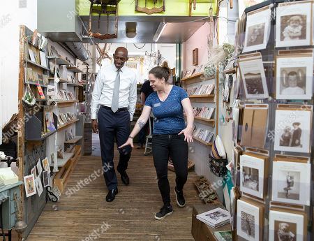 Mayor of Miramar, Florida and Democratic candidate for United States President Wayne Messam (L) gets a tour of the A&E Coffee / Apotheca Flower and Tea Shoppe, with owner Samantha Fox (R) in Goffstown, New Hampshire, USA 21 May 2019. Messam, the son of Jamaican immigrants, is on a two day campaign swing through New Hampshire, the first state to hold a primary for the 2020 Presidential election.