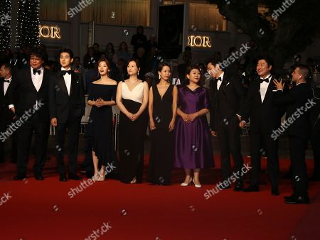 Bong Joon-ho,Choi Woo-shik, Park So-dam, Chang Hyae-Jin, Cho Yeo-jeong, Lee Jung-Eun, Lee Sun-kyun, Kang-Ho Song. Director Bong Joon-ho, from left, actors Choi Woo-shik, Park So-dam, Chang Hyae-Jin, Cho Yeo-jeong, Lee Jung-Eun, Lee Sun-kyun, and Kang-Ho Song poses for photographers upon arrival at the premiere of the film 'Parasite' at the 72nd international film festival, Cannes, southern France