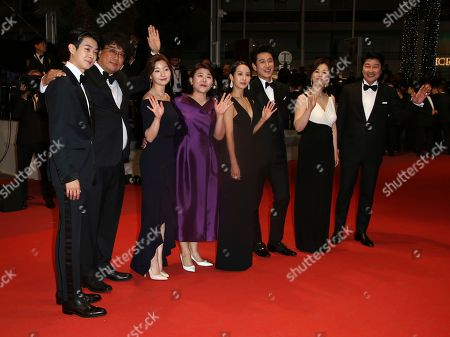 Choi Woo-shik, Bong Joon-ho, Park So-dam, Lee Jung-Eun, Cho Yeo-jeong, Lee Sun-kyun, Chang Hyae-Jin, Kang-Ho Song. Actor Choi Woo-shik, from left, director Bong Joon-ho, actors Park So-dam, Lee Jung-Eun, Cho Yeo-jeong, Lee Sun-kyun, Chang Hyae-Jin, and Kang-Ho Song poses for photographers upon arrival at the premiere of the film 'Parasite' at the 72nd international film festival, Cannes, southern France