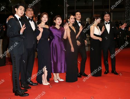 Choi Woo-shik, Bong Joon-ho, Park So-dam, Lee Jung-Eun, Cho Yeo-jeong, Lee Sun-kyun, Chang Hyae-Jin, Kang-Ho Song. Actor Choi Woo-shik, from left, Bong Joon-ho, actors Park So-dam, Lee Jung-Eun, Cho Yeo-jeong, Lee Sun-kyun, Chang Hyae-Jin, and Kang-Ho Song poses for photographers upon arrival at the premiere of the film 'Parasite' at the 72nd international film festival, Cannes, southern France