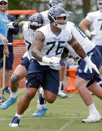 Tennessee Titans offensive guard Rodger Saffold (76) runs a drill during an organized team activity at the Titans' NFL football training facility, in Nashville, Tenn