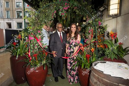 Stock Image of High Commissioner of Jamaica His Excellency Mr. Seth George Ramocan and singer Rebecca Ferguson open The Jamaica One Love Garden at Boisdale venue, Canary Wharf. The 65-meter garden terrance has been transformed into The Jamaica One Love Garden designed by Bruce Dallow, Director of Plant Plan.